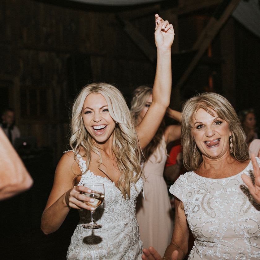 bride and mother dancing