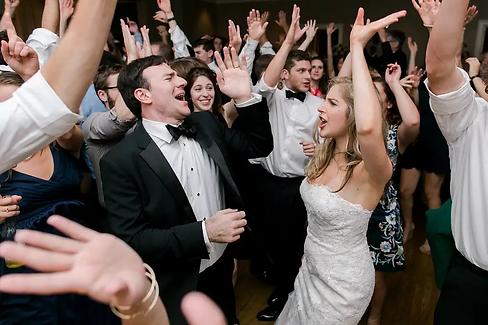 bride and groom hands up.webp