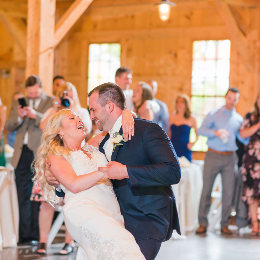 bride gets dipped by groom during first dance