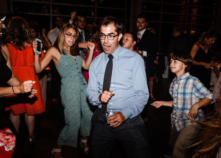 guy and kids dancing at wedding