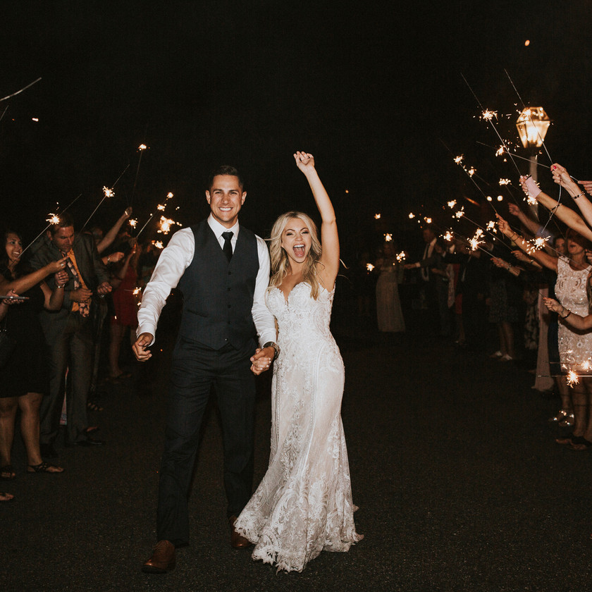 bride and groom walking during sparkler exit