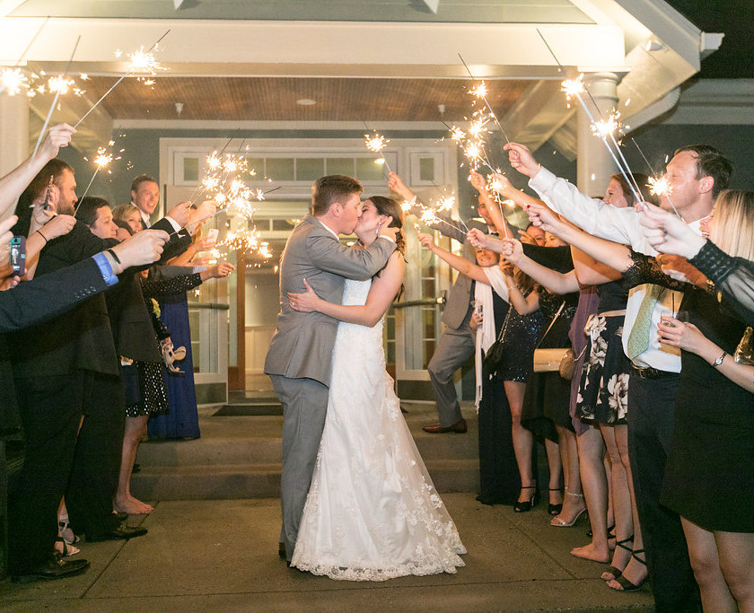 bride and groom kiss during sparkler exit