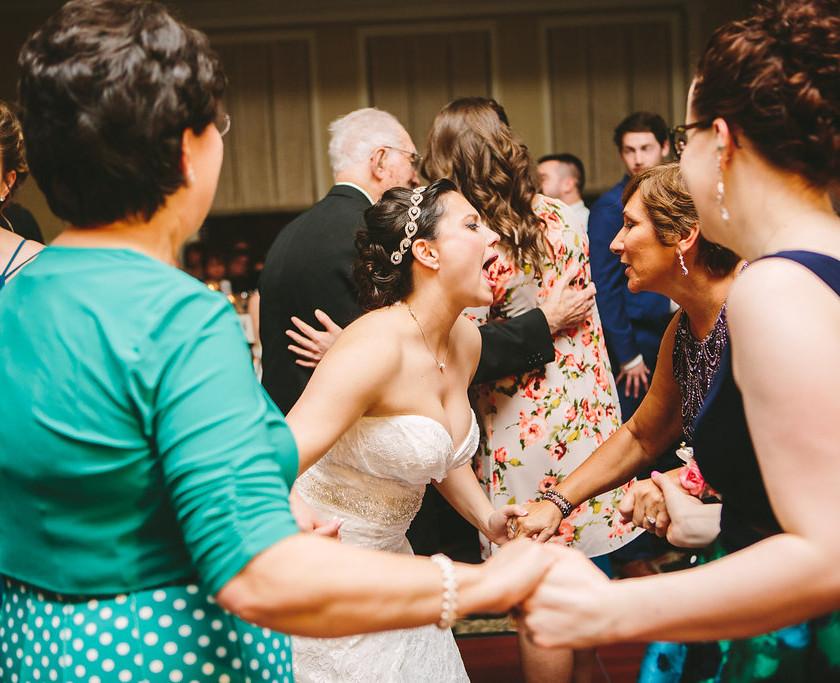 bride sings to older women in group