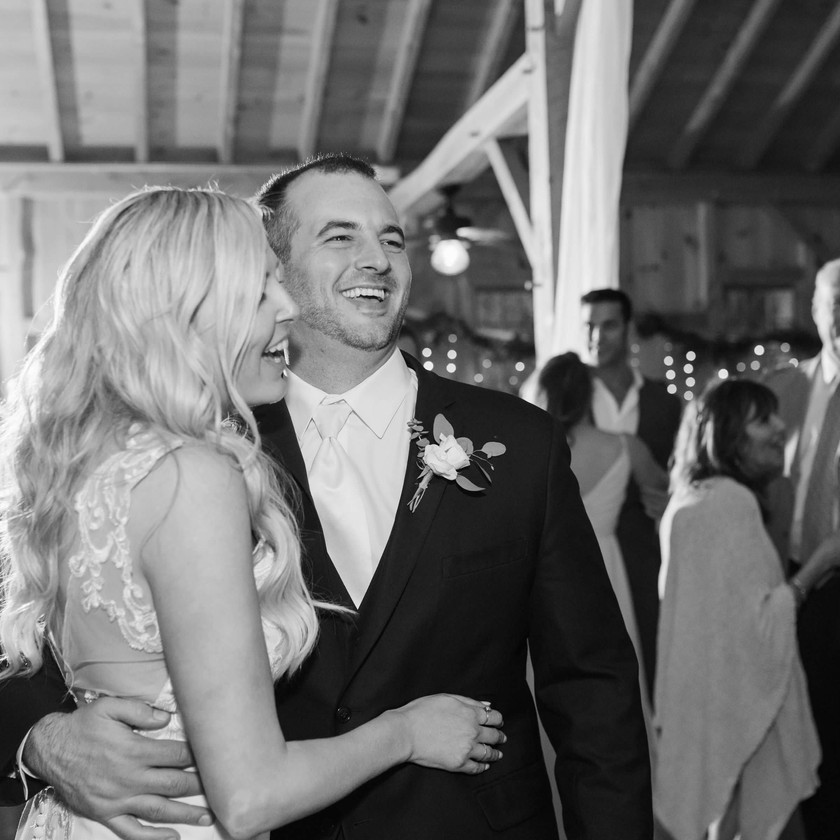 bride and groom laugh during dancing