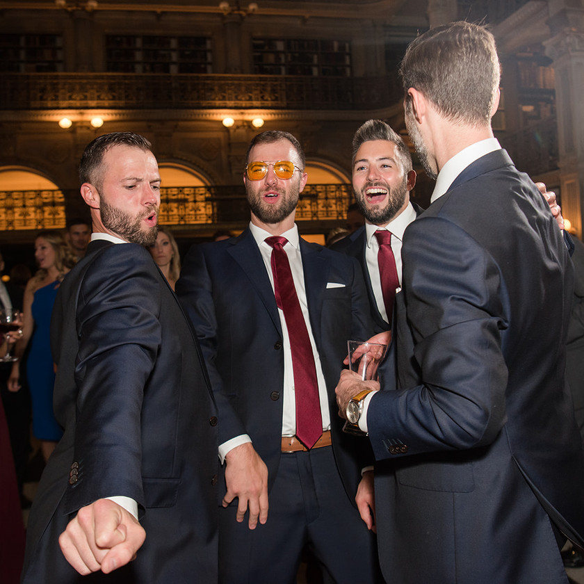 groomsmen dancing at peabody library wedding reception