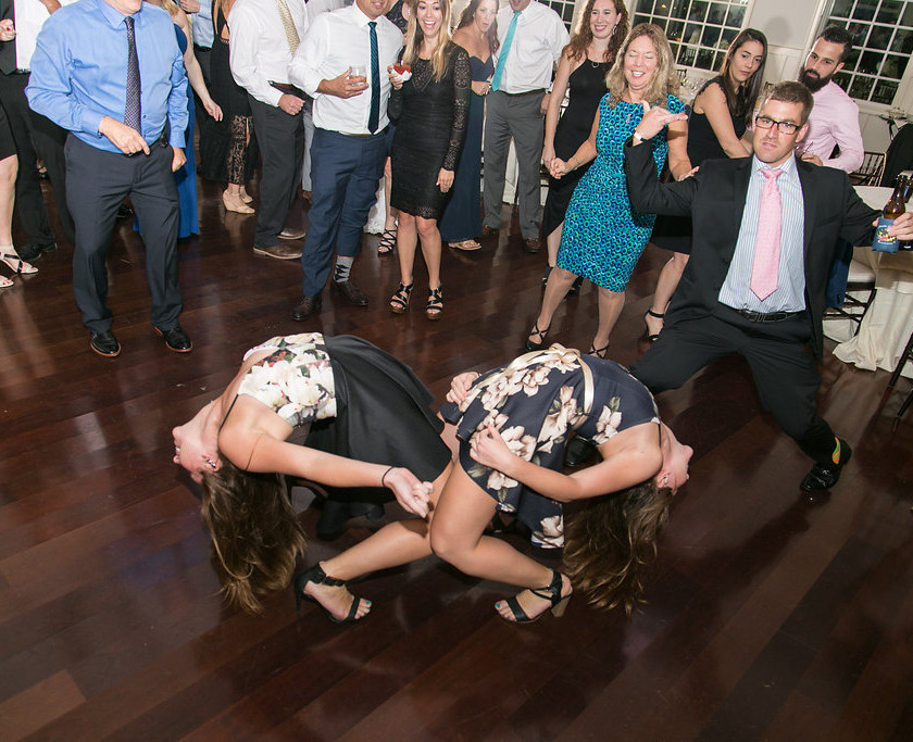 two woman bend backwards on dancefloor
