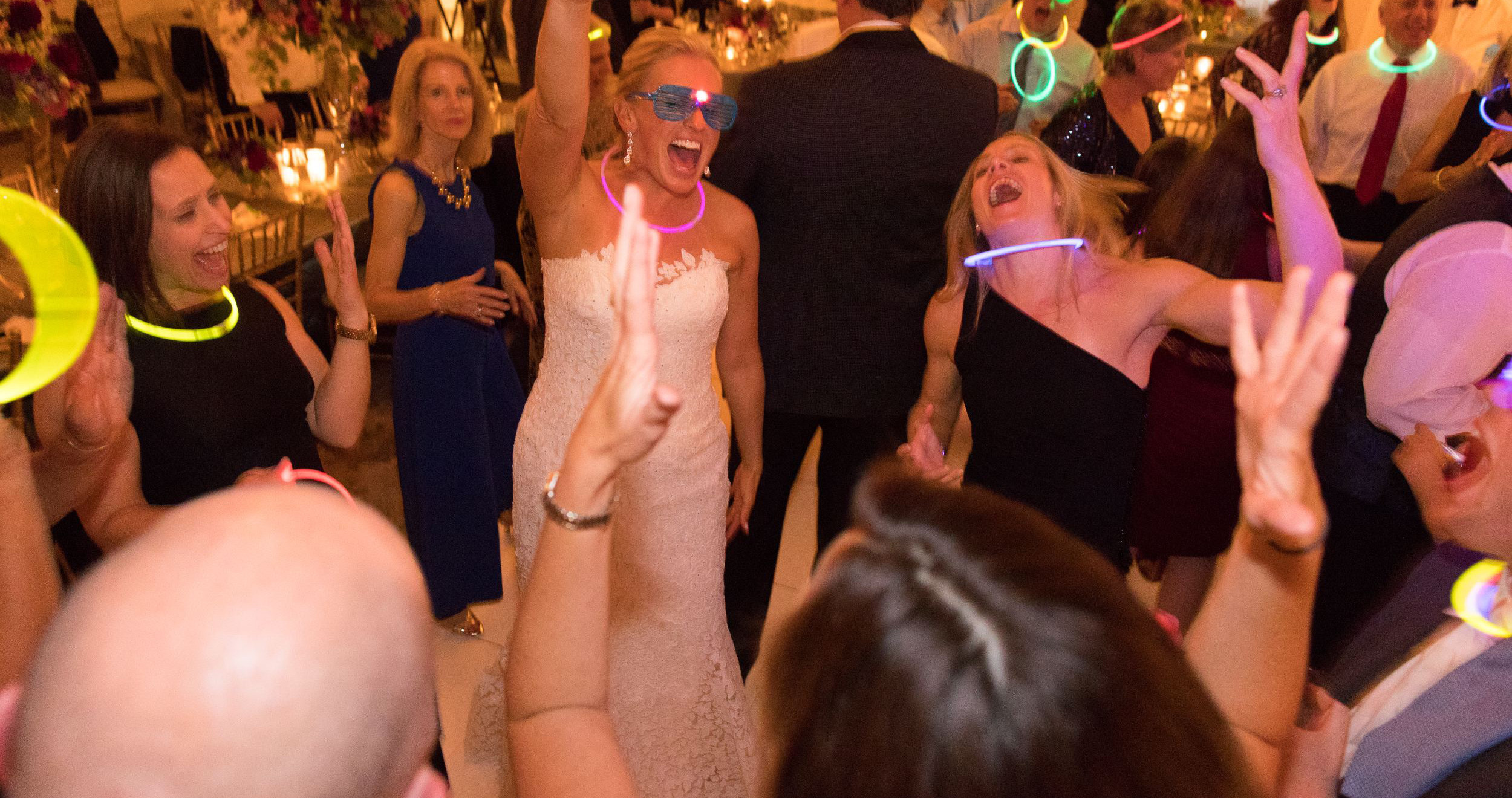 bride smiles and dances with friends
