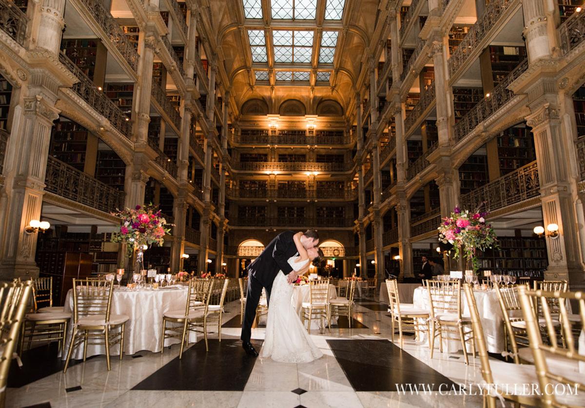 groom kissing bride in library wedding setup