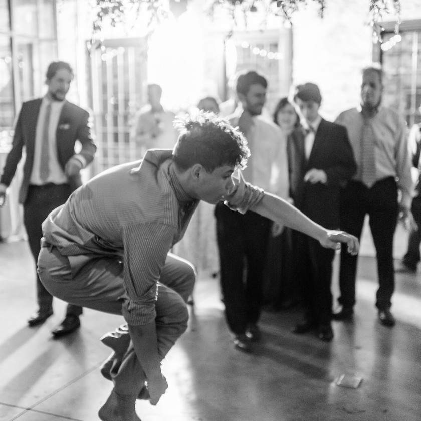 young man jumping up on dance floor