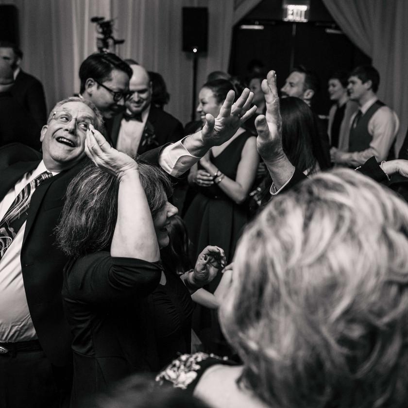 older guests dance at wedding