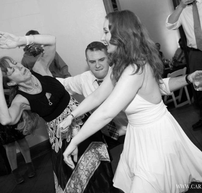bride and guests dance