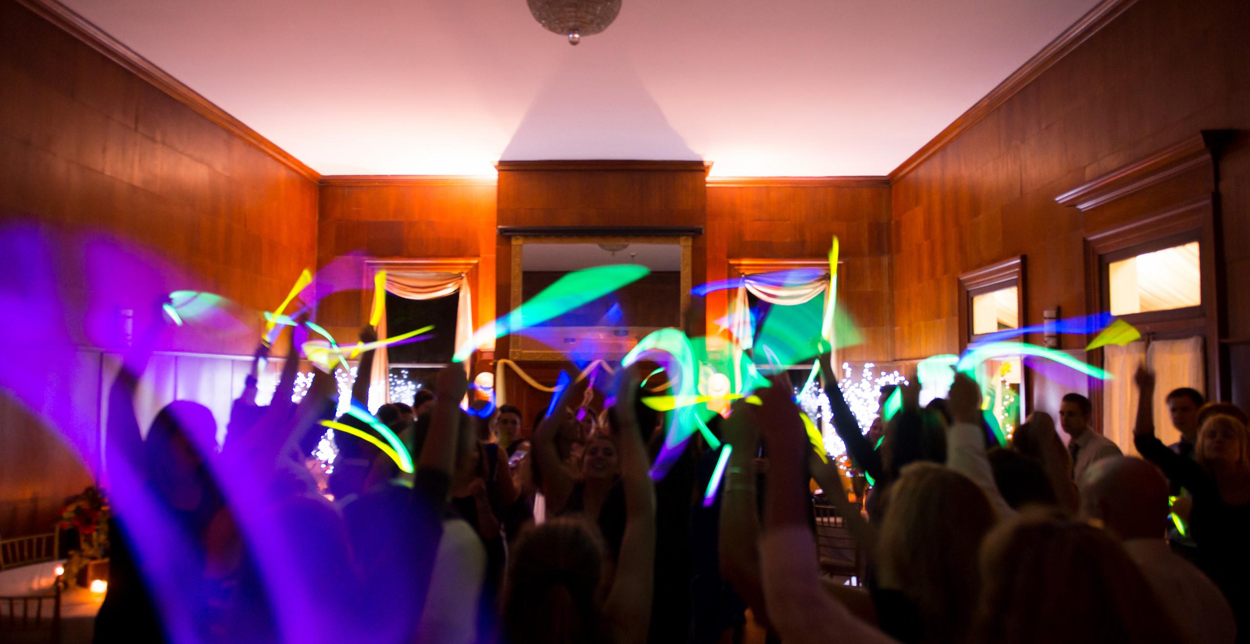 glow sticks waved around during dancing at wedding