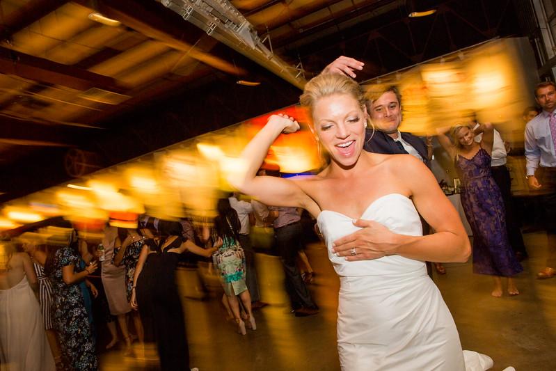 bride smiles while dancing