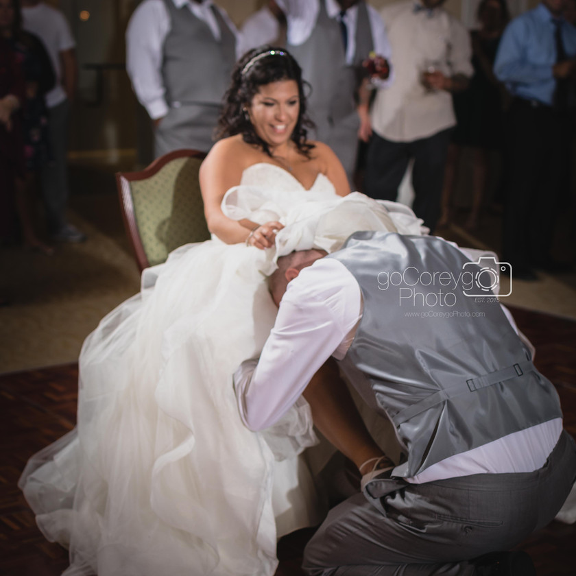 groom removing garter
