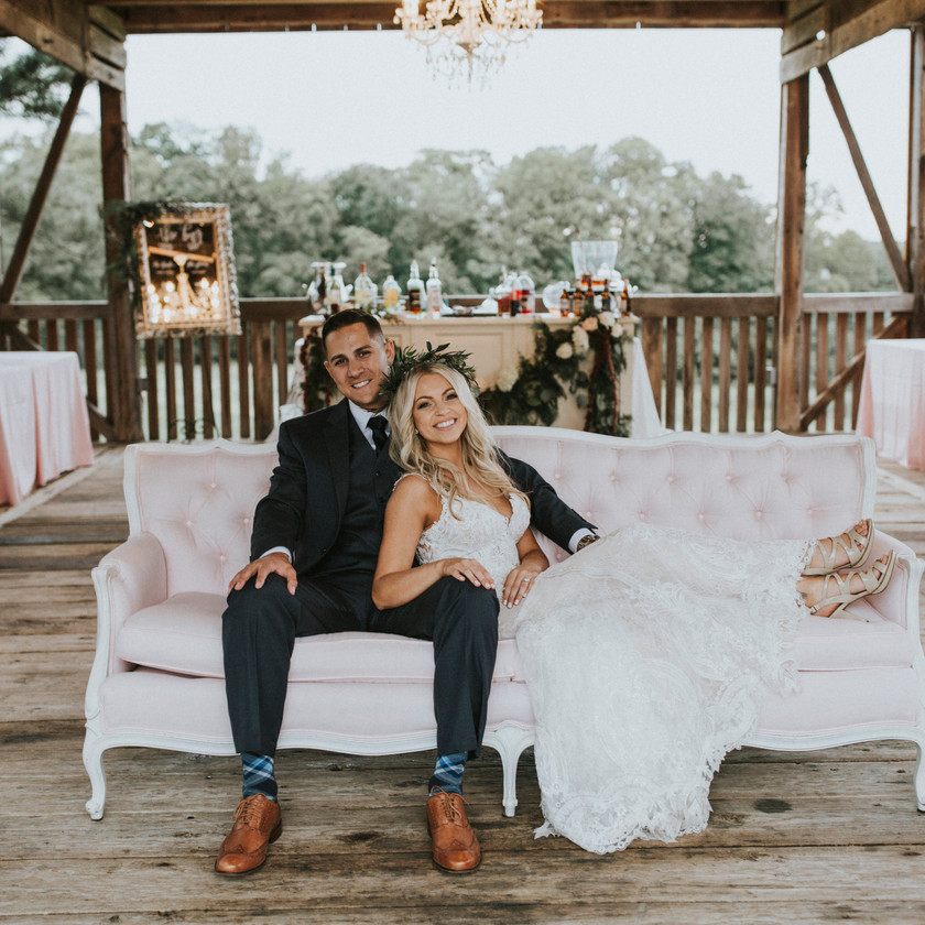 bride and groom sitting on lounge furniture