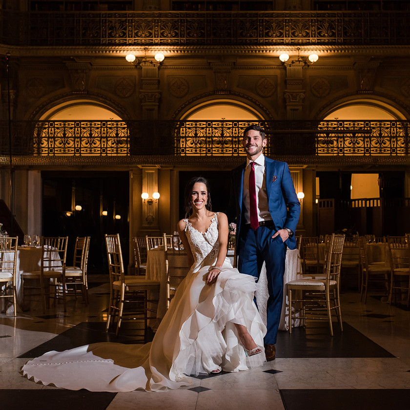 bride and groom at peabody library wedding reception