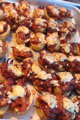 Chefs line pulled pork stuffed baby bakers topped with smoked blue crumle