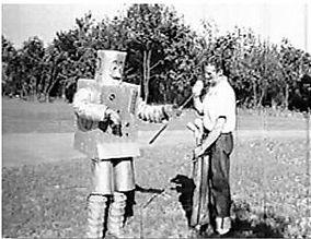Alan Scott teaches golf to Mr. Rivets.JP