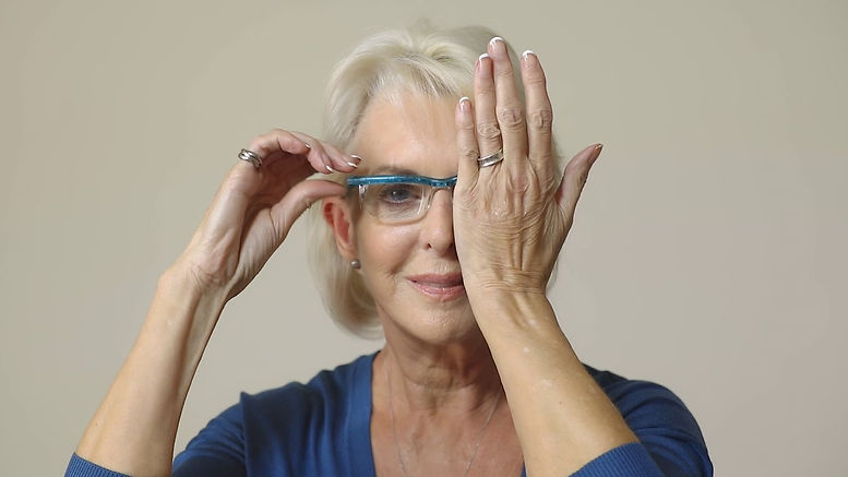 Woman adjusting Glasses.jpg