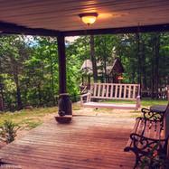 Porch at Vacation Rental Log Cabin
