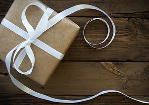Gift With White Ribbon With Frame.jpg