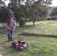 Volunteer with push mower