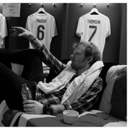 Lot 51 - Ed Sheeran Photograph Alone in the Dressing Room after Second Night at Wembley Stadium, 2015 Signed by Photographer Mark Surridge and Ed Sheeran. Print donated by ThePrintSpace