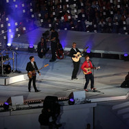 Lot 90 - Photograph of Nick Mason, Richard Jones, Ed Sheeran and Mike Rutherford Performing Pink Floyd's  Wish You Were Here at the Olympics Closing Ceremony, London, 2012 Signed by all 4 Musicians