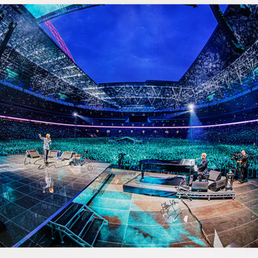 Lot 140 - Ralph Larmann Photograph of Ed Sheeran and Elton John Performing Together at Wembley Stadium, 10 July 2015  Uniquely Signed by Ed Sheeran, Elton John and Ralph Larmann