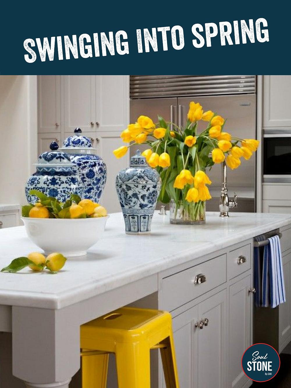 yellow tulips and yellow lemons on kitchen natural stone island