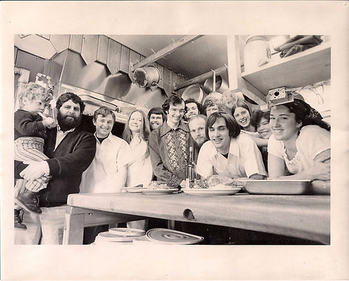 Photo from 1973 at Emmaus Road Restaurant. Sam Risho being held by his father Ray, Emmaus Raod owner and founder.
