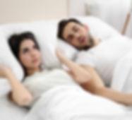 Woman-awake-because-of-snoring.jpg