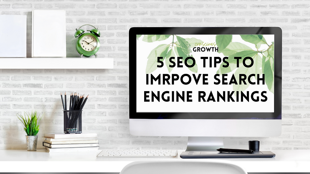 """White modern desk with a desktop monitor that has """"5 SEO Tips to Improve Search Engine Rankings"""" written on the screen"""