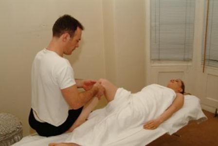 Daniel treating a knee injury