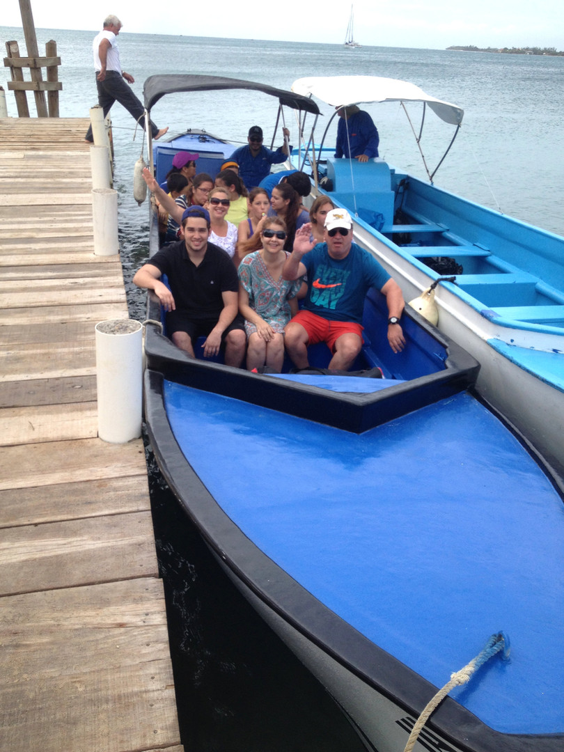 Our Guest Heading to Water Caye.jpg