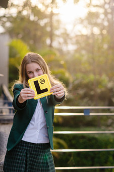 happy teen with L-plate