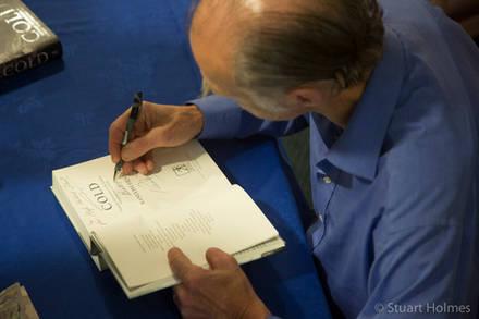 Ran Fiennes signs