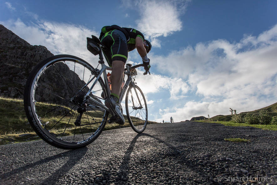 Cyclist at the start of Hardknott Pass
