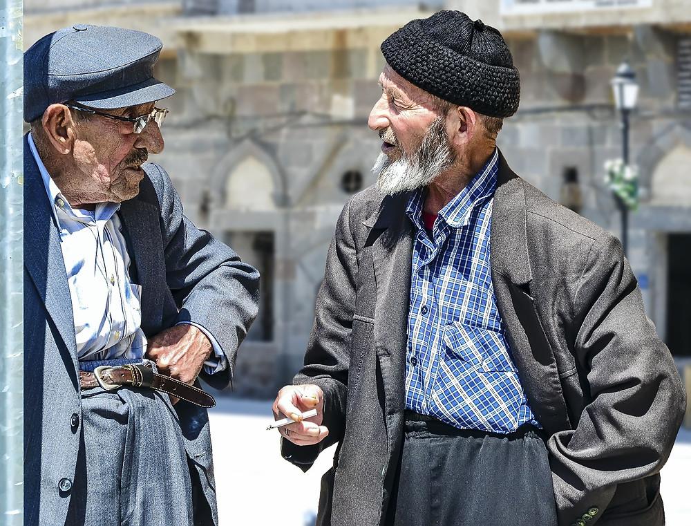 Two men speaking - learning English through conversation