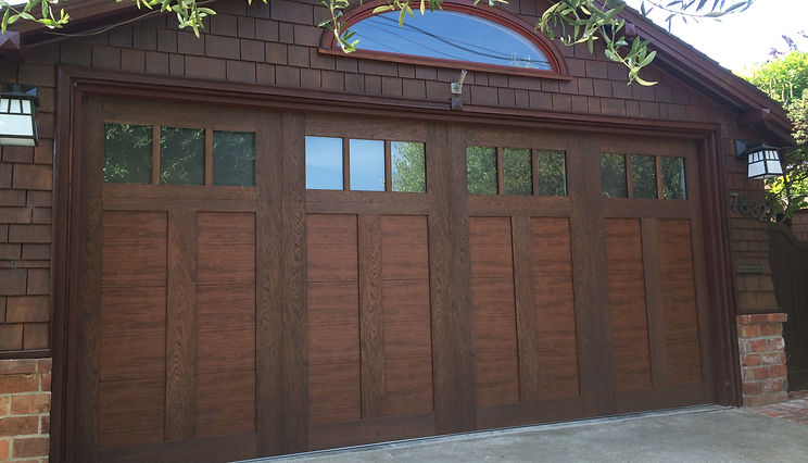 New garage door installation. Garage Door Repair. Clopay Canyon Ridge steel garage door wood grain texture garage door installation