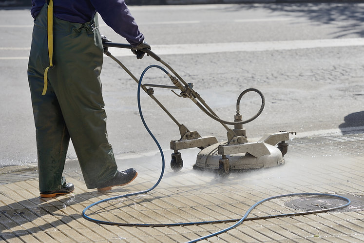 worker washes the pavement.jpg