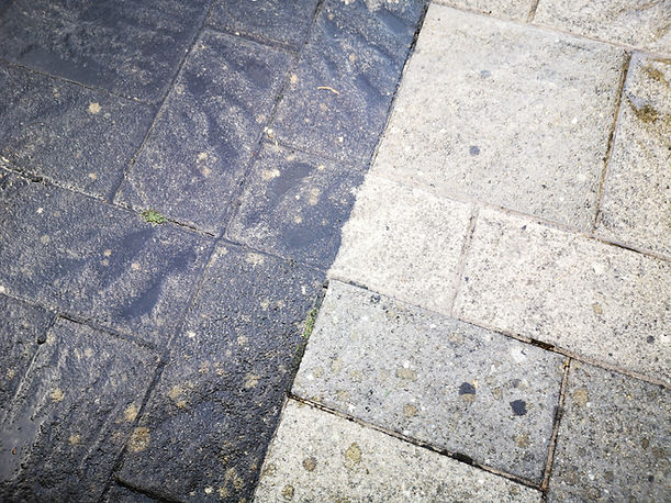 Close up of before and after patio clean