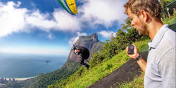 paragliding pilot taking off.