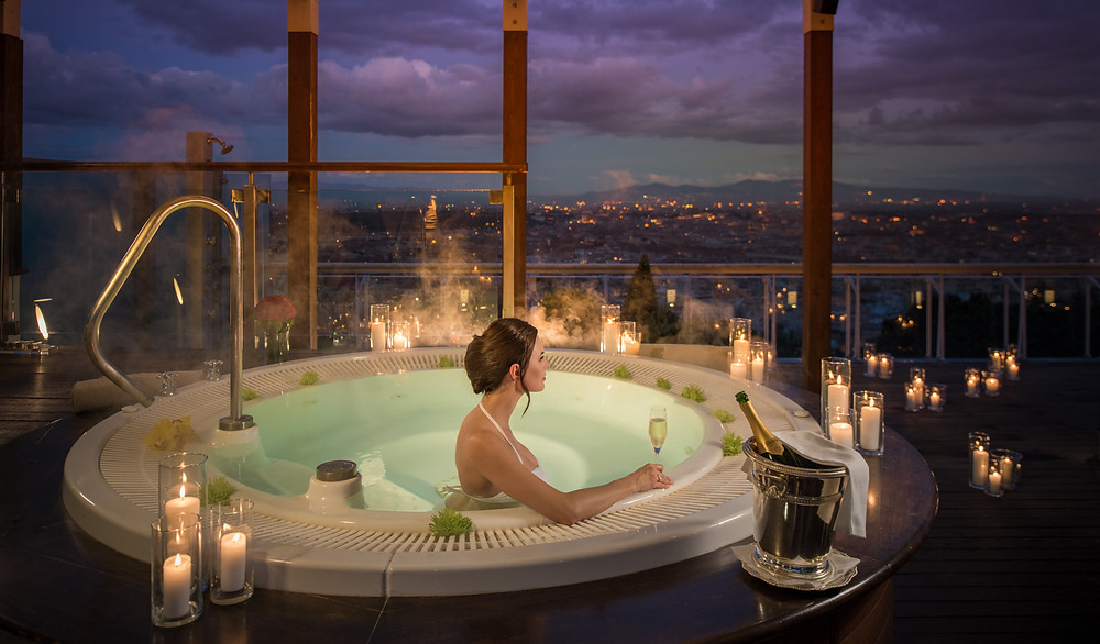 The Cavalier Waldorf Astoria Penthouse in Rome includes a tub overlooking the Eternal City