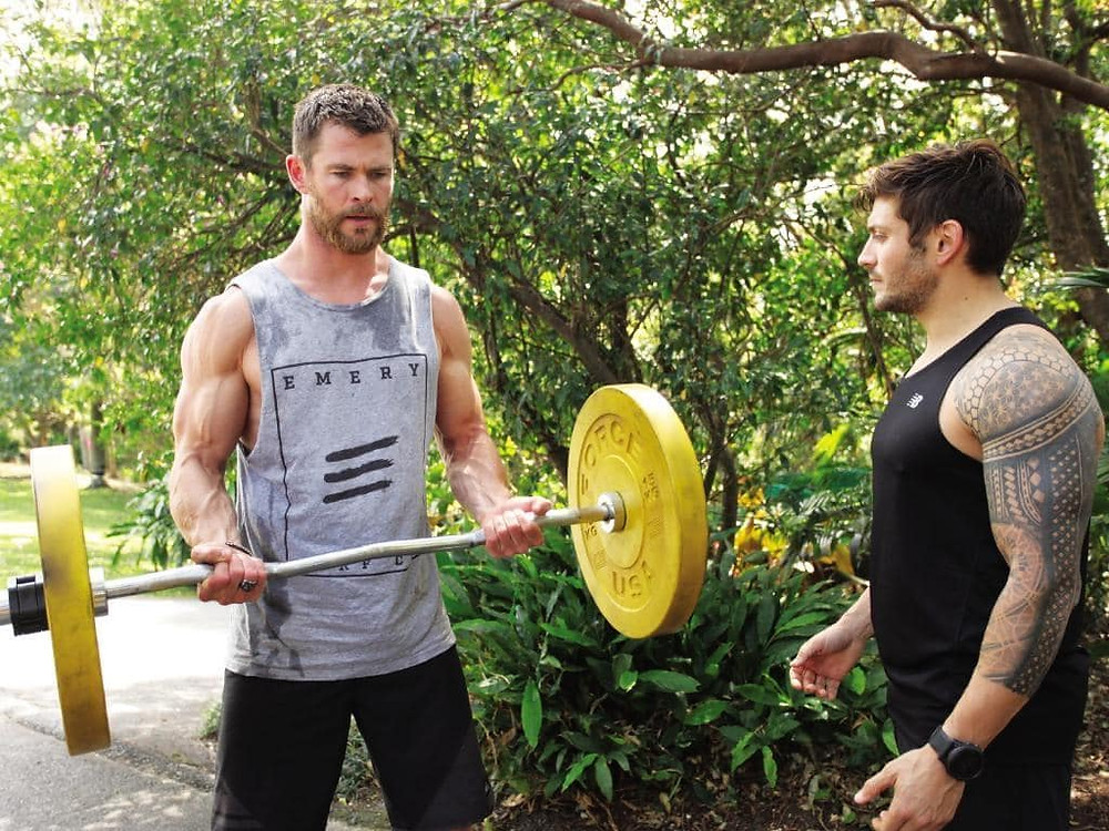 Celebrity trainer, Luke Zocchi, helping actor Chris Hemsworth build his famous biceps