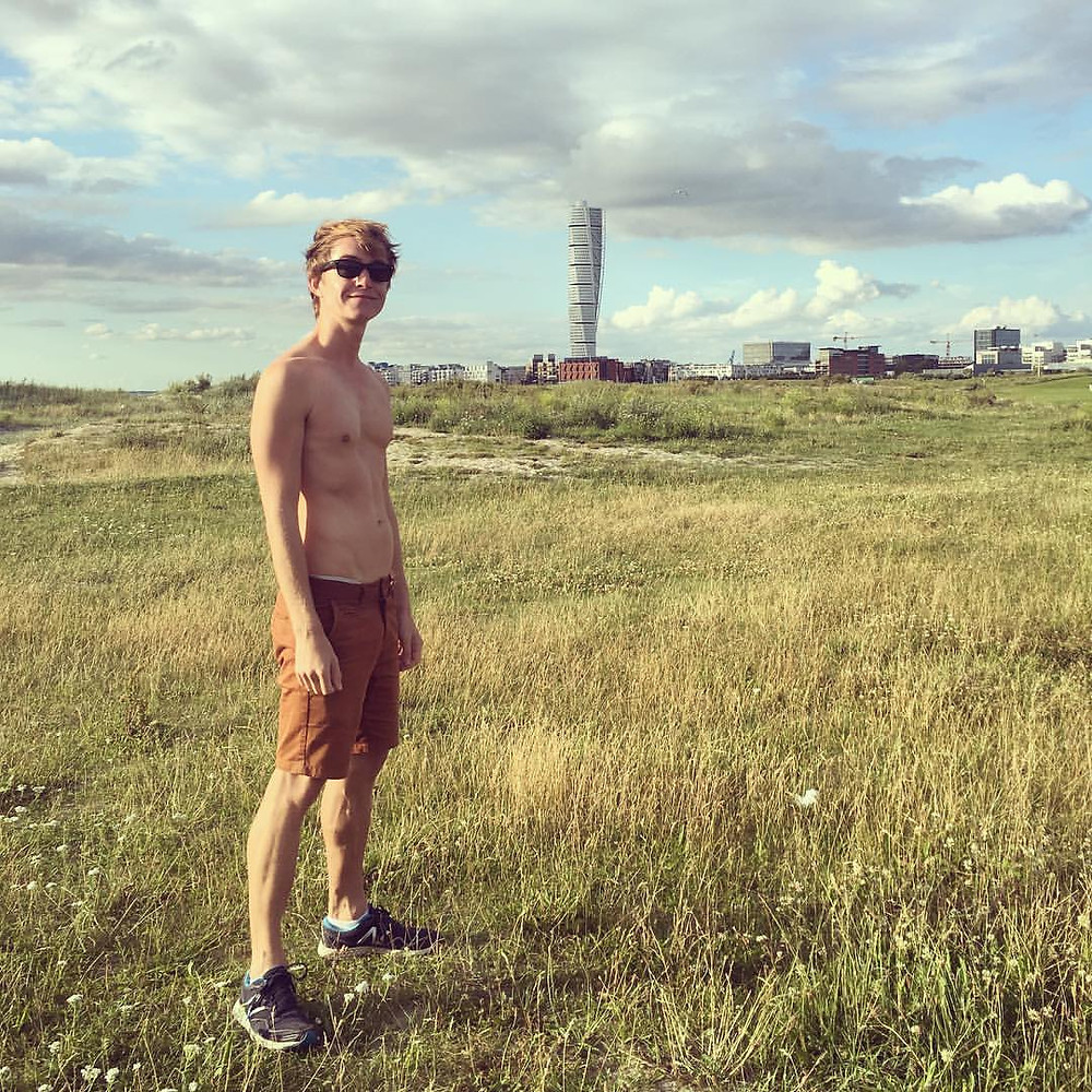 Post-sauna with his modesty covered, Paul explores the Malmo foreshore near the sauna