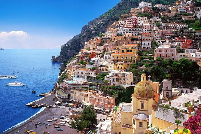 Pastel-hued buildings dot the rocky cliff face of Amalfi's most popular destination - Positano
