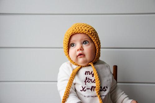 Muts 'bonnet' okergeel