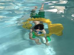 underwater through his tummy