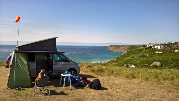 VW campervan on clifftop